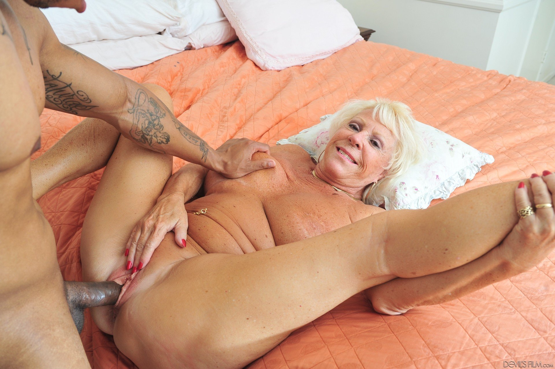 Two Horny Grannies Fuck Teen With A Strapon