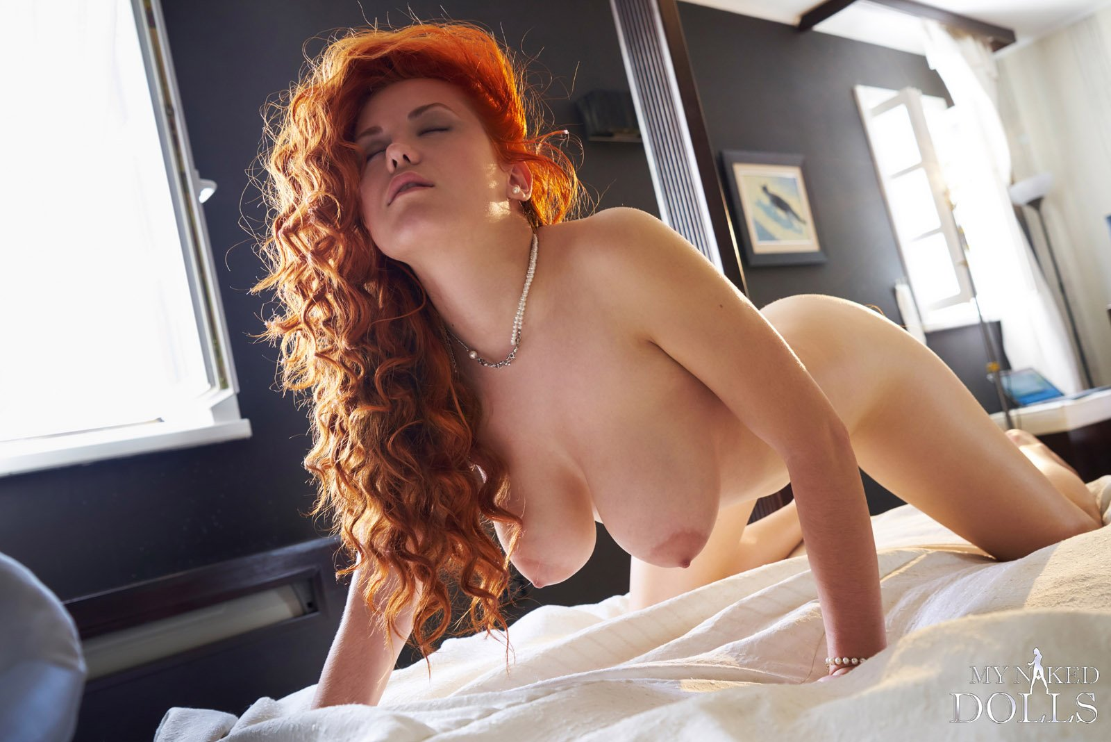 Curly brunette lady with big natural boobs looking