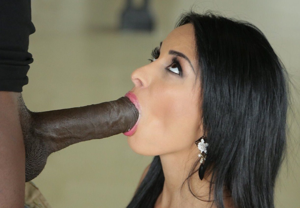 Brunette giving handjob on huge dick and recording along with her cell phone