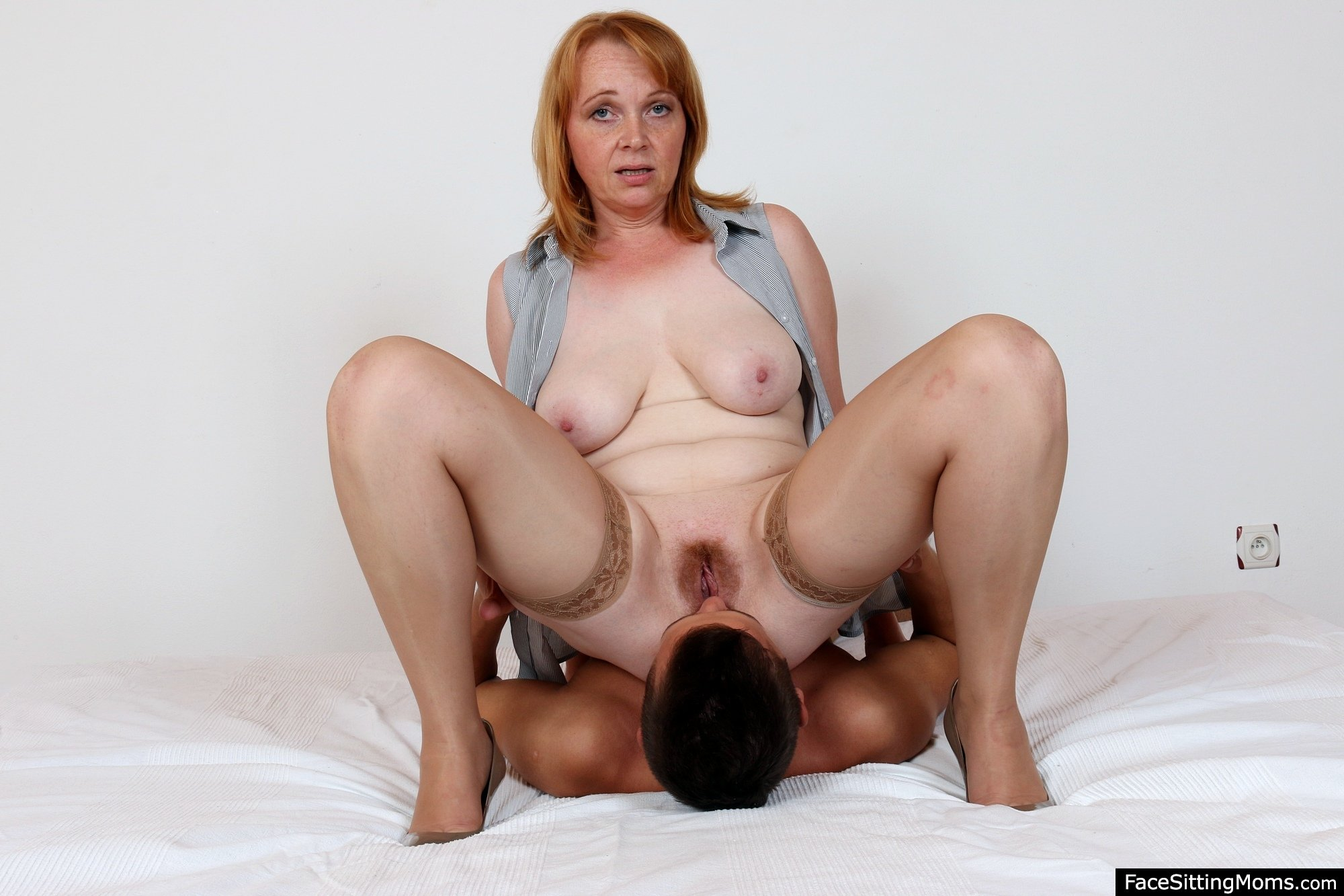 Lovely amateur housewife has two guys satisfying her needs photo